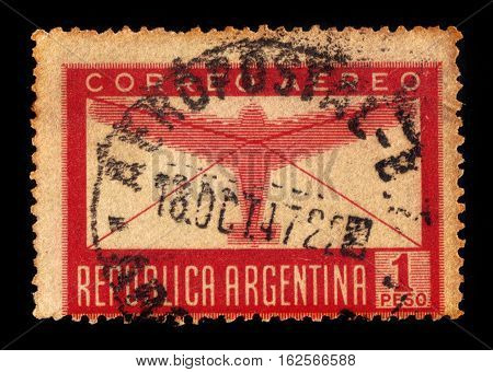 Argentina - CIRCA 1940: A stamp printed in Argentina shows airplane silhouette against the backdrop of the letter, circa 1940