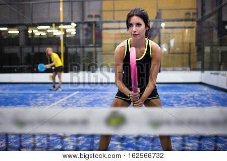 Two Young Women Playing Paddle Tennis.
