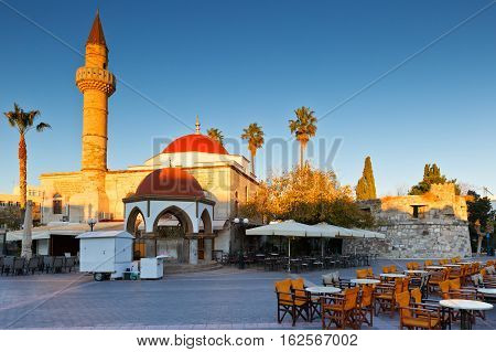 Mosque and coffee shops in the main square of the Kos town.