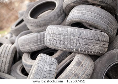 Pile of used rubber tyres. Recycling industry