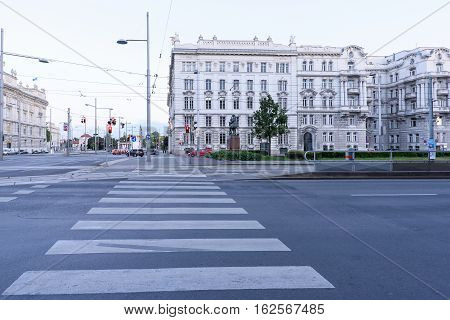 VIENNA, AUSTRIA - MAY 16, 2016: city street at karlsplatz at sunset, soviet soldier memorial