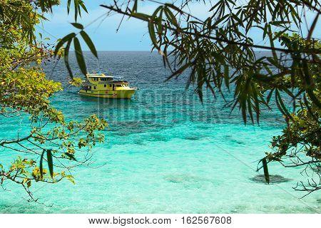 View of  a beautiful tropical bay and a ship. Thailand, Raya Island