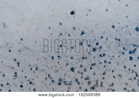 Background of wet white snow with drops of melting icicles