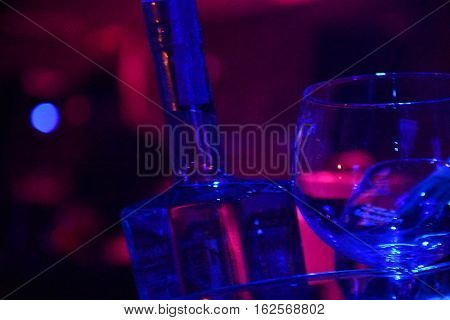 bottle and glass in the nigth club