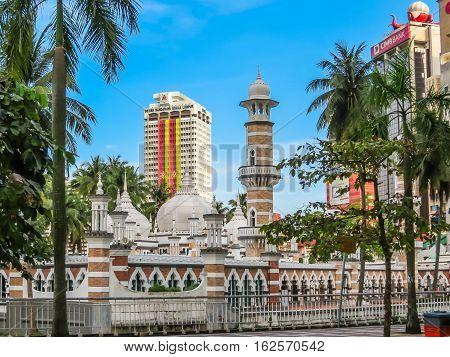 KUALA LUMPUR, MALAYSIA - JANUARY 12, 2014: Masjid Jamek Mosque. Cityscape of Kuala Lumpur, Malaysia