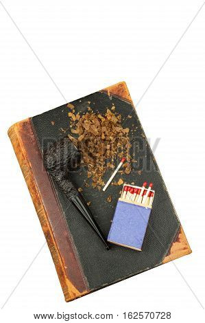 Smoking pipe and antique books. Tobacco pipe on ancient books. Relax by reading old books. Smoking. Risk of cancer. Isolated on white.