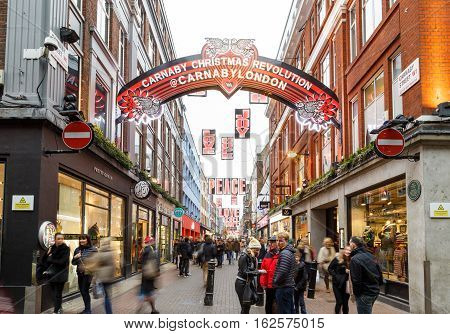 LONDON ENGLAND - DECEMBER 17: 'Carnaby Christmas Revolution' sign on Carnaby Street London. In London England. On 17th December 2016.