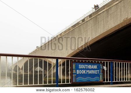 LONDON ENGLAND - DECEMBER 17: Plaque for South Bank Book Market under Waterloo Bridge London. In London England. On 17th December 2016.