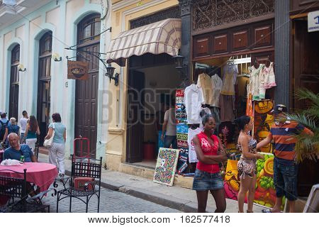 HAVANA, CUBA - NOVEMBER 3, 2012: The streets of the city, street scene with locals and tourists alike.