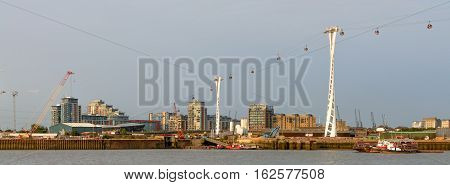 London United Kingdom - August 17: Air gondolas over River Thames on August 17 2016 in London United Kingdom. River Thames is the longest river entirely in England and the second longest in the United Kingdom