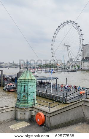 London United Kingdom - August 20: London Eye on August 20 in London. London Eye is the giant ferris wheel at the South bank of River Thames in London England