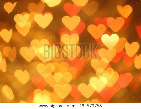 Bokeh blurred background of colored lights in the shape of heart.