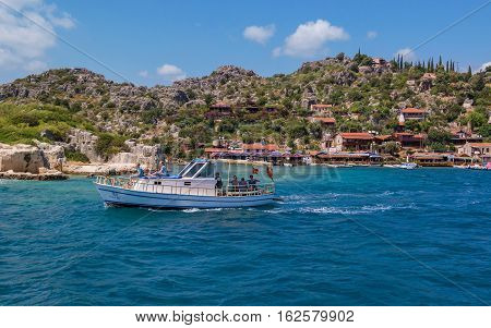 Antalya, Turkey - April 26, 2014: Kalekoy village on the Turkish island of Kekova. The island is Castle, a fortress of the Knights of Malta.