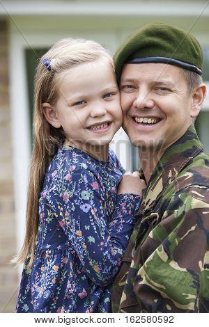 Portrait Of Soldier On Leave Hugging Daughter