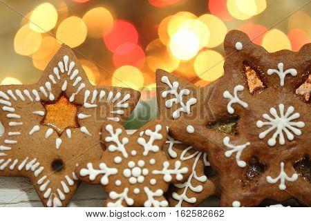 Christmas homemade gingerbread cookies. Bokeh lights background.