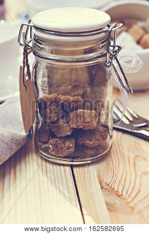 Brown sugar  on wooden background.  sugarcane, cooking