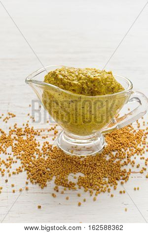 Gravy boat with French mustard sauce and seeds