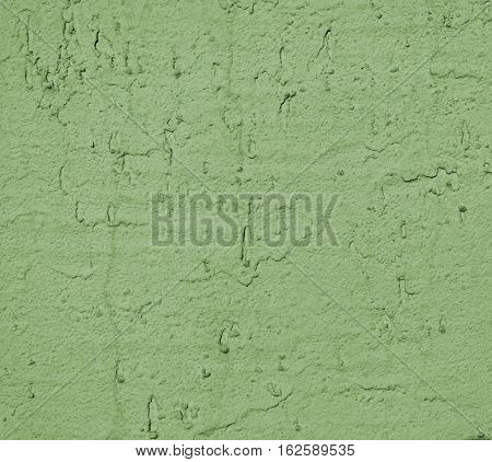 Plaster, plaster green color on a concrete wall. Stucco green wall background or texture. Plaster, plaster texture, plaster background. Green wall.