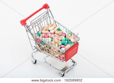Trolley Full Of Pills On White Background