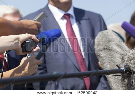 Media interview with businessman or politician. Press conference.