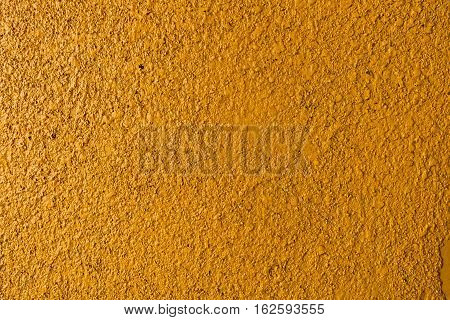 Plaster, plaster yellow color on a concrete wall. Stucco ochre wall background or texture. Plaster, plaster texture, plaster background. Yellow wall, yellow background. Color plaster.