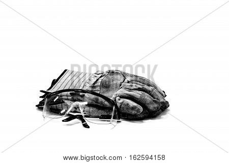 Indusytial safety glasses and gloves laying on a white background