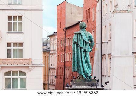 Main Market Square in Krakow. Monument on the square near the church of St. Mary. Details. Poland