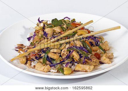 Studio Shot Of Stir Fried Chicken Chop Suey And Chopsticks
