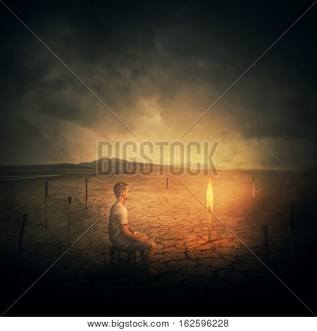 Surrealist concept as a man sitting on a chair in the middle of a desert looking at a single burning matchstick through a set of another extinguished burnt matches.