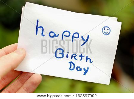 Hand written Happy birth day paper note being held