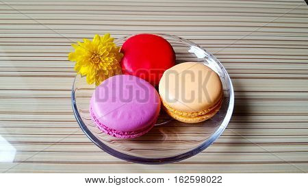 Macaron is a French confection of egg whites, powdered sugar, granulated sugar, ground almonds and food coloring. Red, orange and pink