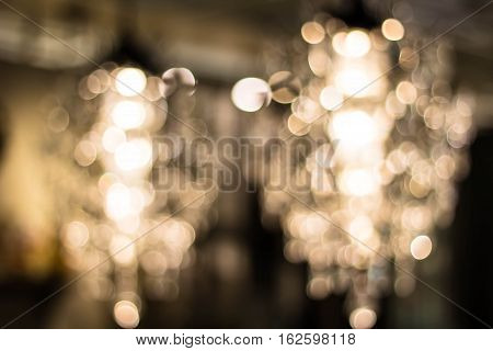 Texture pattern background. light crystal chandelier with blurred focus