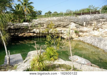 Side view of cenote in Mexico area.
