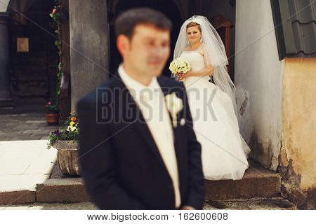 Bride Looks With Pride In Her Eyes At Fiance