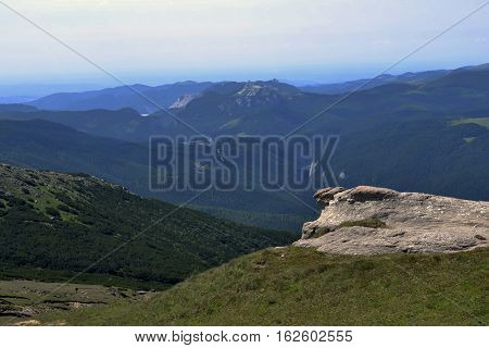 Bucegi view. Dull heights, steep valleys, alpine meadows, cliffs huge tourists trails