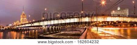 Panoramic night view of Moscow from the backlight lights. The picturesque bridge in the center of the Russian capital. Government House of Russia