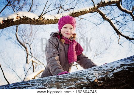 Happy Child Girl Wearing Winter Jacket in Winter Park