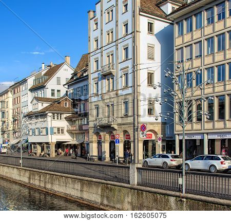 Zurich, Switzerland - 19 December, 2016: view along the Limmatquai quay with Christmas illumination lamps temporarily installed for the Christmastime. Zurich is the largest city in Switzerland and the capital of the Swiss canton of Zurich.