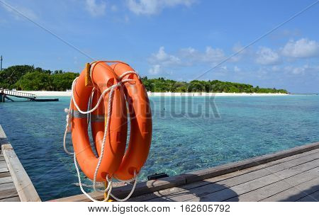 a nice photo of an orange lifesaver