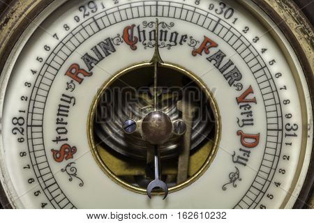 Climate change. Slightly simplified image of a vintage barometer forecasting a change in the weather. Connotations of climate change and global warming.