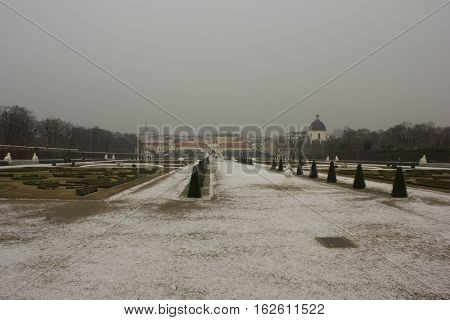 VIENNA, AUSTRIA - JANUARY 1 2016: Winter view of Schloss Belvedere Park in Vienna looking at lower Belvedere in a snowy and foggy day