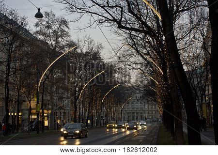 VIENNA, AUSTRIA - JANUARY 1 2016: Christmas lighting on the trees in Vienna at twilight time