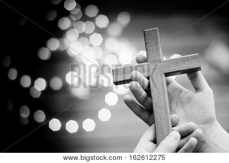 Little Boy Child Praying And Holding Wooden Crucifix
