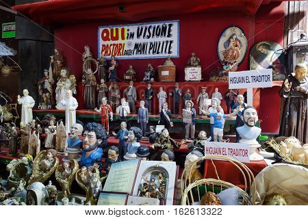 Naples Italy - December 9 2016: Statuettes handmade representatives famous celebrities sports politics music and religion. Stand facing San Gregorio Armeno street famous for the sale of nativity scenes and religious statues and celebratory.