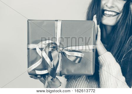 Person Holding Gift Box.