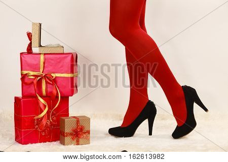Female Legs In Red Pantyhose And Many Gift Boxes