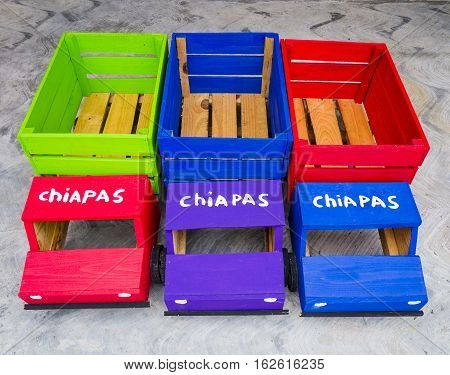 Colorful mexican toy trucks with the inscription