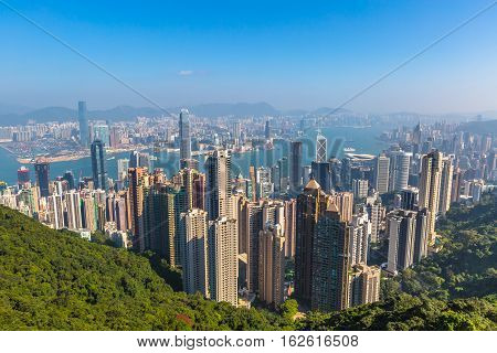 Aerial view of Victoria Harbour and skyscrapers from Lugard Road Lookout, the panoramic point most photographed within the Peak Circle Walk. The Victoria Peak, the highest mountain in Hong Kong Island