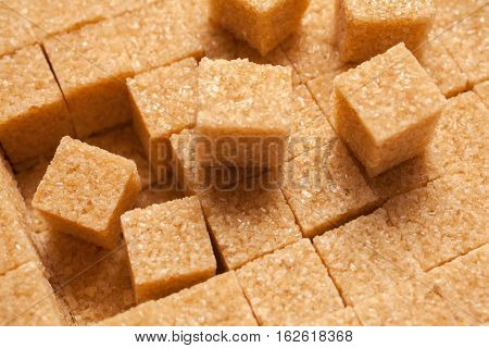 Brown sugar cubes. Food background up view