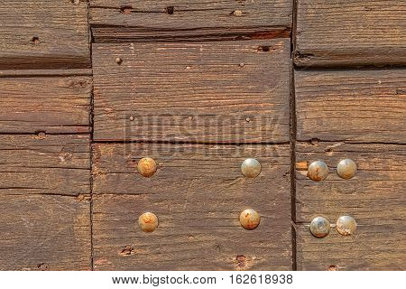 Detail of old wooden door of the typical house in Tucepi village, Croatia.